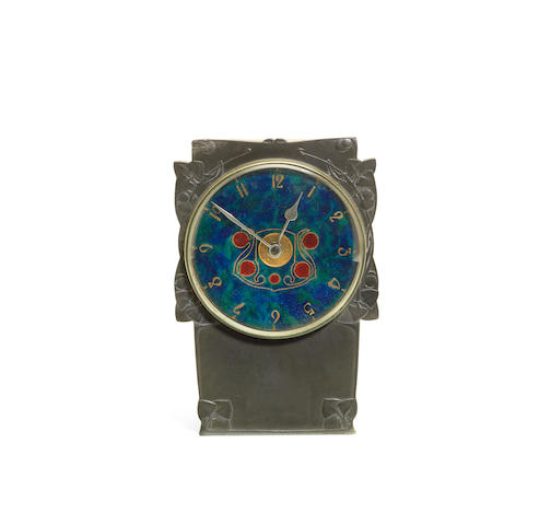 An Archibald Knox 'Tudric' Pewter and Enamel Clock for Liberty & Co. STAMPED LIBERTY MARKS; CIRCA 1905