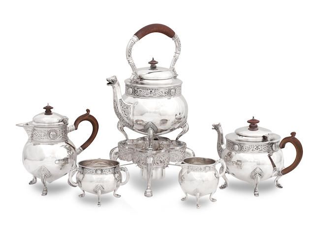 An early 20th century five piece silver tea service by Wakely & Wheeler, London 1909/10