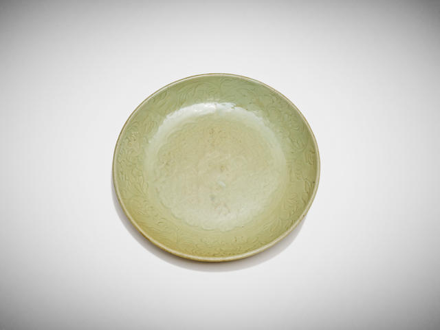 A chinese carved longquan celadon charger 15th to 16th century