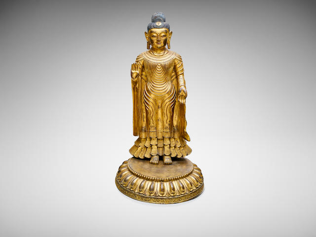 A Chinese gilt-bronze standing figure of a Maitreya