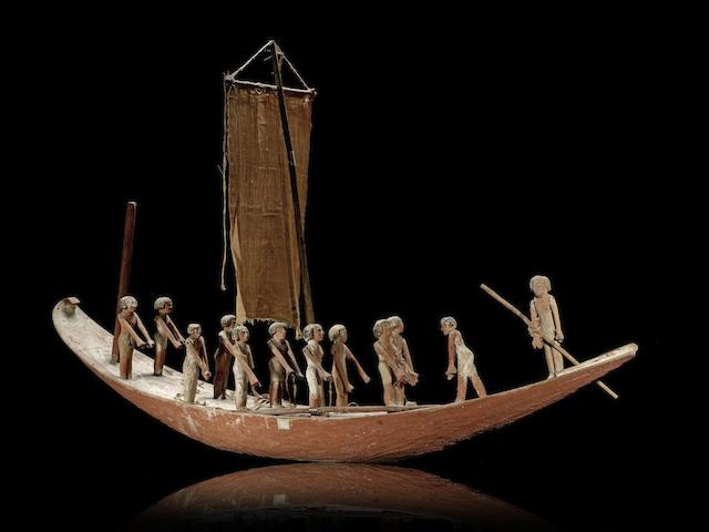 A large Egyptian gesso-painted wood model boat
