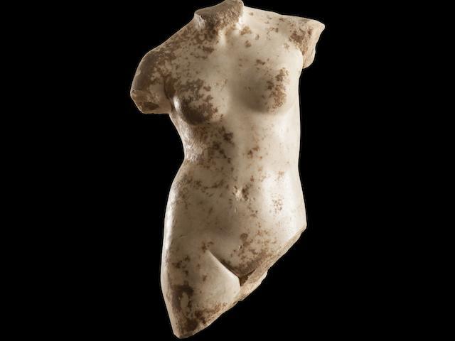 A Roman marble torso of Aphrodite Anadyomene