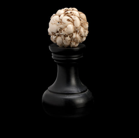 An ivory sphere carved with rats and an octopus Meiji