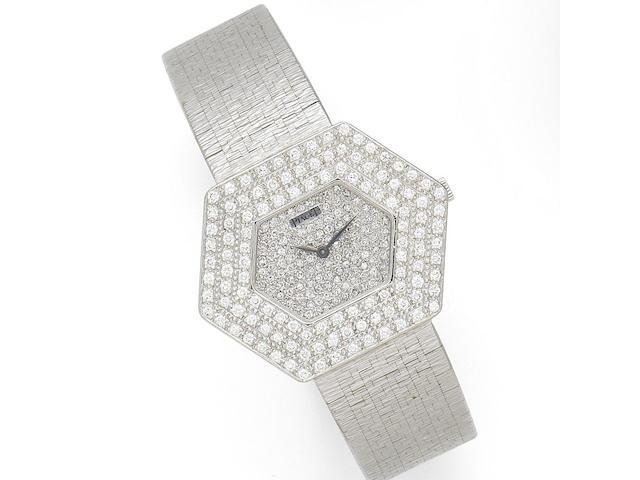 Piaget. An 18K white gold and diamond set manual wind hexagonal bracelet watch Ref:99055A6, Case No.2 85609, Circa 1990