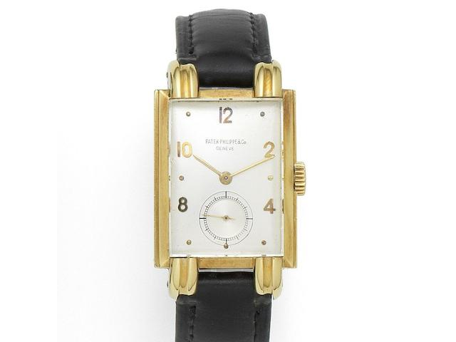 Patek Philippe. An 18K gold manual wind rectangular wristwatch Ref:1480, Case No.509852, Movement No.838697, Manufactured in 1946, Sold 28th February 1947