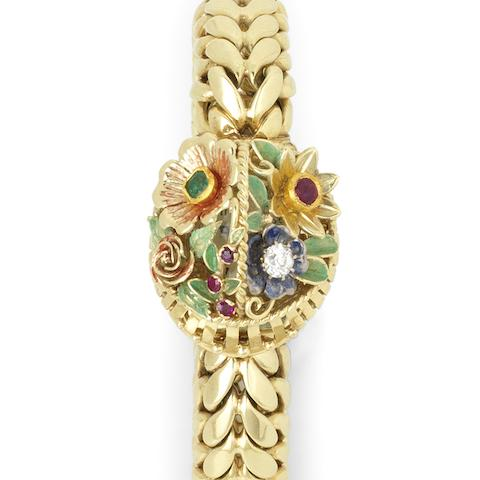 A lady's 14K gold and stone set manual wind bracelet watch with concealed dial Case No.12730, Circa 1960
