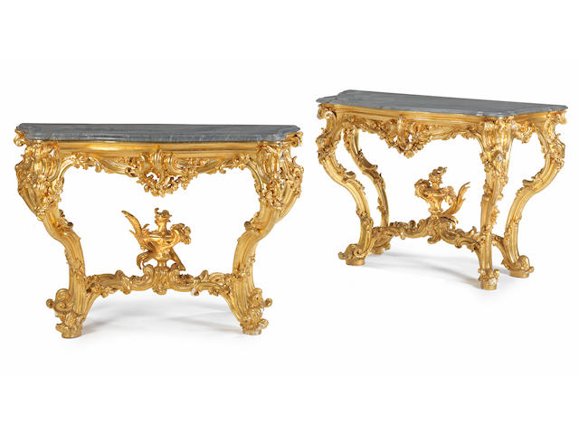 A pair of North Italian carved giltwood console tables18th century and re-gilded (2)