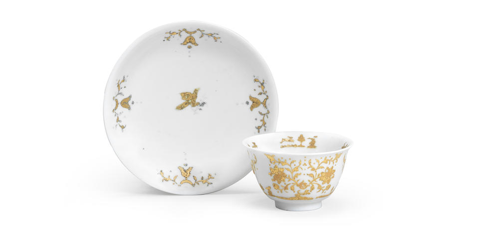 An early Meissen teabowl and saucer with gold Paillon decoration, circa 1720-30