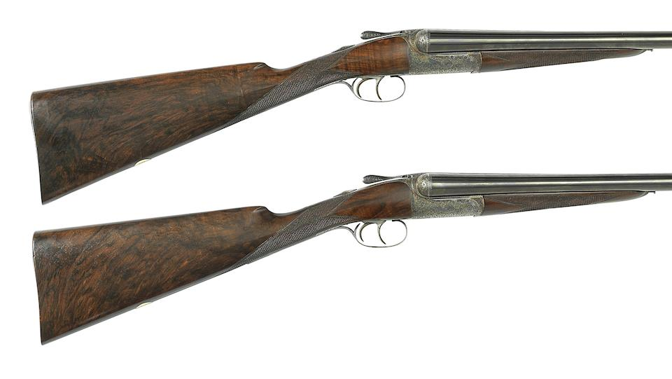 A fine pair of 12-bore round-action ejector guns by David McKay-Brown, no. 7485/6 In their leather motorcase