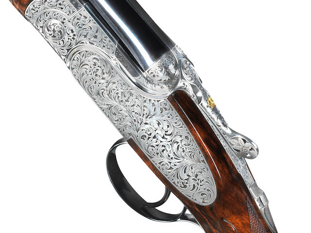 A fine Arici-engraved 20-bore 'SO10' single-trigger over-and-under sidelock ejector gun by P. Beretta, no. SO0140B In its leather case with makers accessories