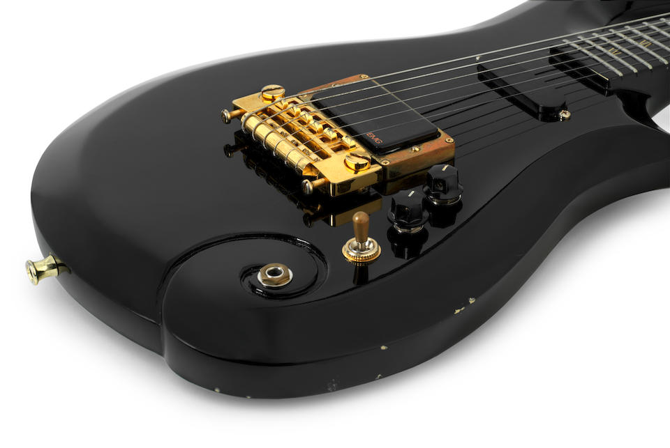 Prince: a custom-made Cloud guitar in black finish, numbered 4, taken on the Act I & II, Prince and the New Power Generation tours, 1993,