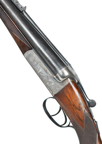 A fine .450/400 (3in. Nitro Express) boxlock ejector rifle by W.J. Jeffery, no. 25380 In its brass-mounted canvas case