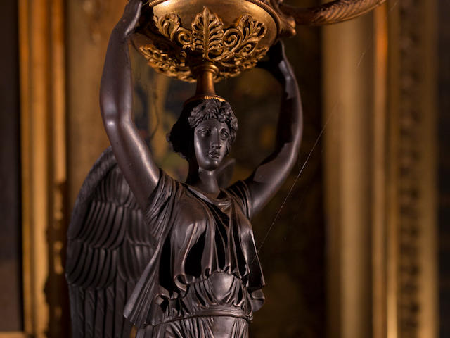 A pair of early 19th century French Empire bronze and ormolu three-light candelabraIn the manner of Pierre-Philippe Thomire, (2)