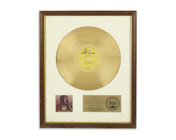 Jimi Hendrix: A 'Gold' sales award for the album 'Rainbow Bridge', early 1970s,