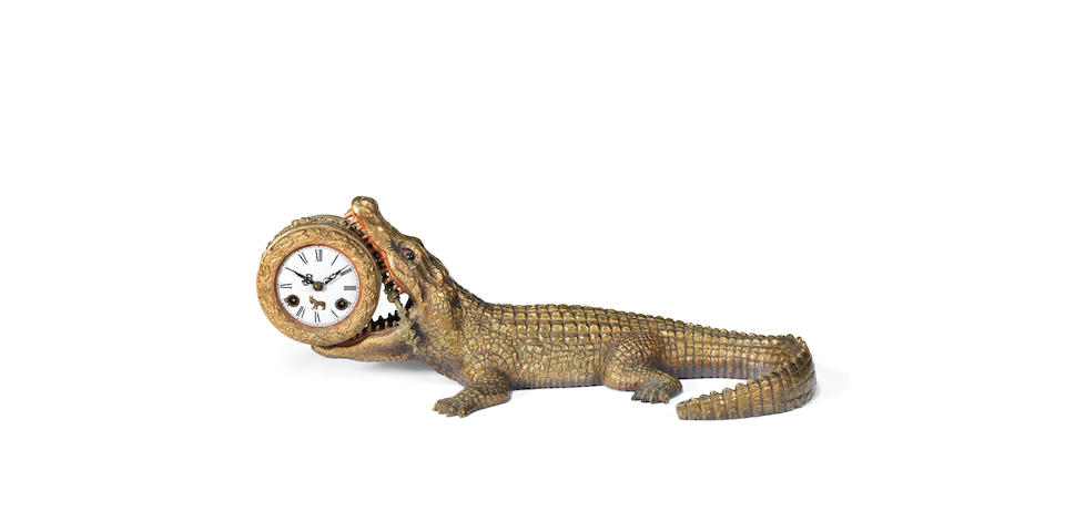 An early 20th century gilt and cold painted bronze novelty crocodile clockpossibly Austrian, the case influenced by the crocodile in the Peter Pan Stories of J.M. Barrie