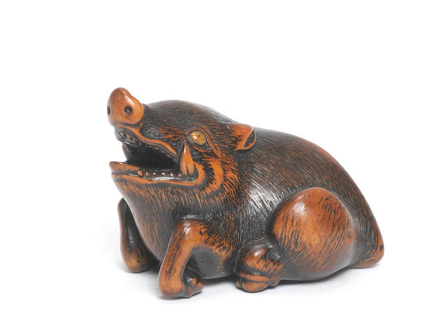 A wood netsuke of a recumbent wild boar By Naito Toyomasa (1773-1856), Tanba Province, early 19th century