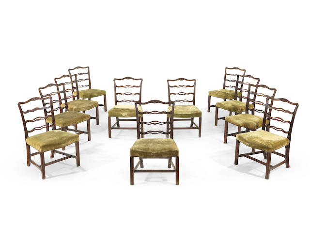 A set of eleven George III carved mahogany ladder-back dining chairs (11)