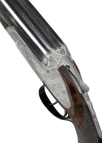 A fine .470 sidelock ejector rifle by J. Rigby & Co., no. 17777 In a brass-mounted leather case with J. Rigby & Co. trade-label