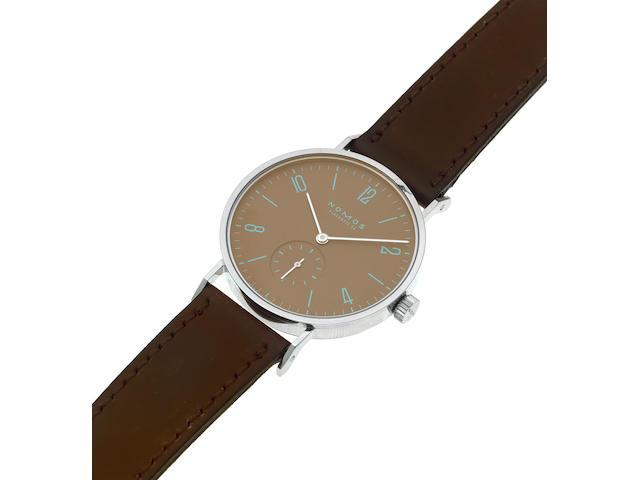 Nomos. A stainless steel manual wind wristwatch Model: Tangente