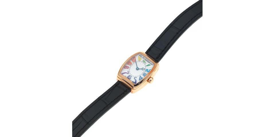 Dubey & Schaldenbrand. A lady's 18K rose gold manual wind tonneau form wristwatch Model: Baby Dôme