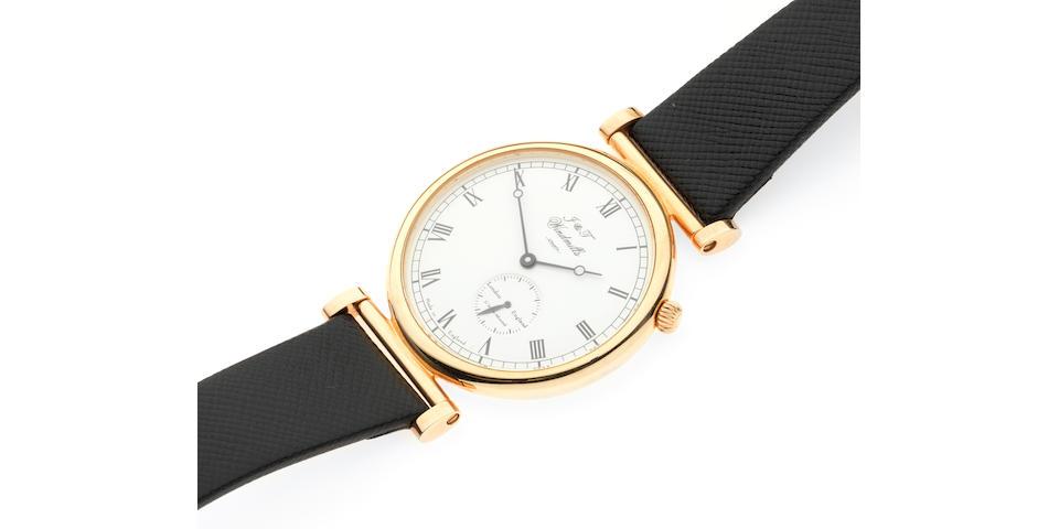Joseph and Thomas Windmills. An 18K rose gold manual wind wristwatch