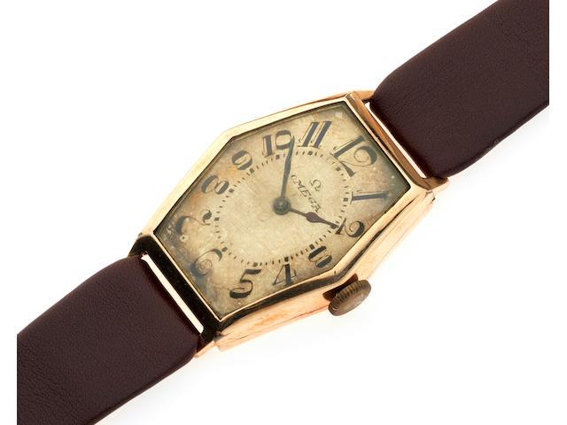 Omega. A rose gold manual wind tonneau form wristwatch