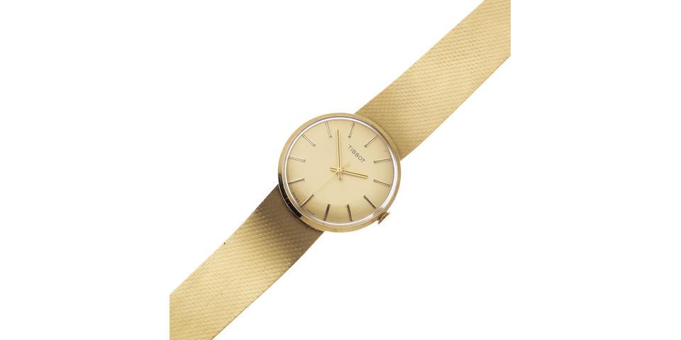 Tissot. A 14K gold manual wind bracelet watch Circa 1960
