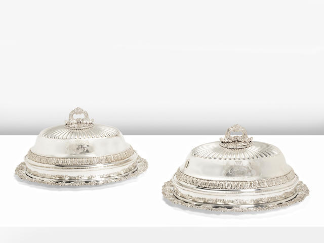 A Pair of George III silver meat dishes by Paul Storr, London 1819, with Old Sheffield Plate covers