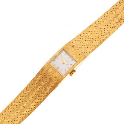 Longines. A lady's 18K gold manual wind bracelet watch Circa 1970