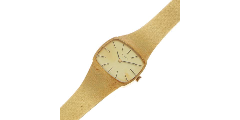 Tusal. A 14K gold manual wind bracelet watch Circa 1960