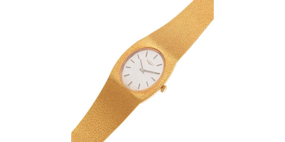 Longines. An 18K gold manual wind bracelet watch Circa 1980