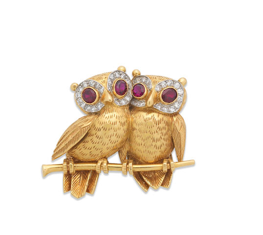 A ruby and diamond owl brooch, by Cartier,