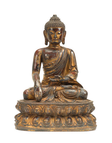 A large gilt-lacquered bronze figure of Buddha 16th century