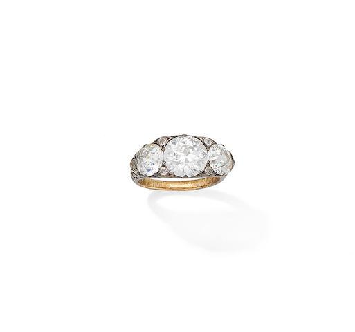 A late 19th century diamond three-stone ring