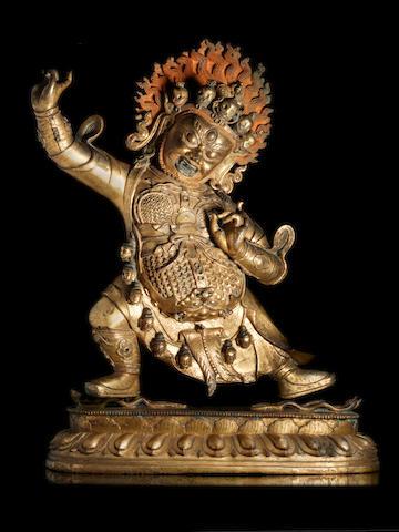 A rare and large gilt-bronze figure of Dharmapala Begtse Chen 18th century (2)