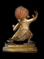 A rare and large gilt-bronze figure of Dharmapala Begtse Chen 18th century (2)