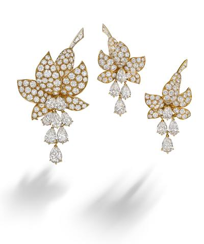 A diamond 'Fuchsia' brooch and earclip suite, by Van Cleef & Arpels,