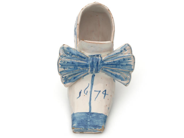 An important English delftware shoe, dated 1674