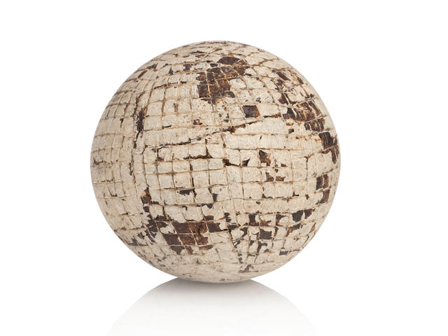 Tom Morris: a hand cut gutta-percha golf ball circa 1860s