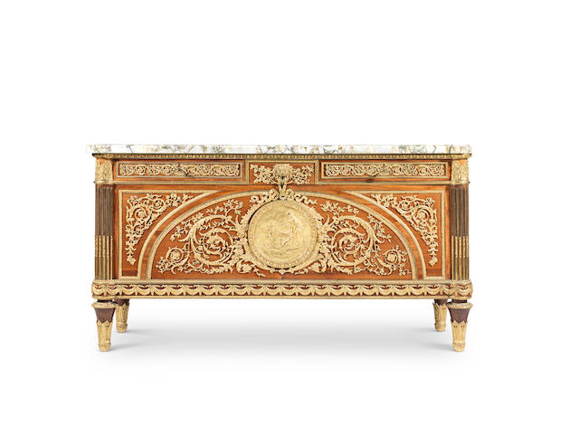 A French late 19th/early 20th century bois satine commode a vantaux  After an eighteenth century model by Benneman
