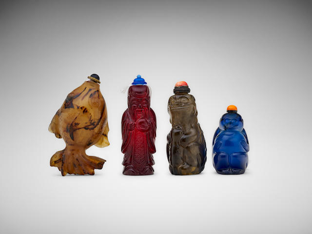 Four Chinese carved hardstone and glass snuff bottles 19th century and later (4)