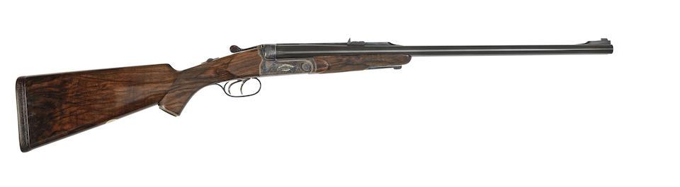 A fine Hunt-engraved .500(Nitro Express) boxlock ejector rifle by W.J. Jeffery & Co., no. 40511 In its brass-mounted faux crocodile skin case
