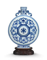 An exceptionally rare pair of Imperial blue and white 'Bajixiang' moonflasks, bianhu  Qianlong seal marks and of the period  (6)