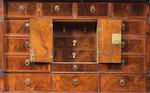 A George I burr walnut, walnut and featherbanded cabinet on chest circa 1715