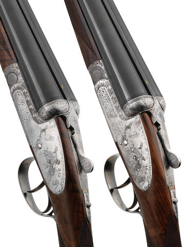 A pair of 12-bore self-opening sidelock ejector guns by Anderson Wheeler, no. 31-03-052-12 & 31-03-053-12 In their leather case
