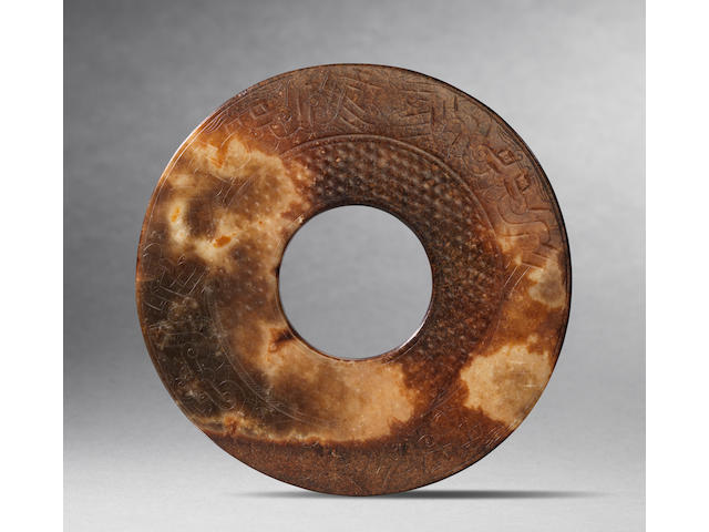 A rare and large yellow jade disc, bi Han Dynasty