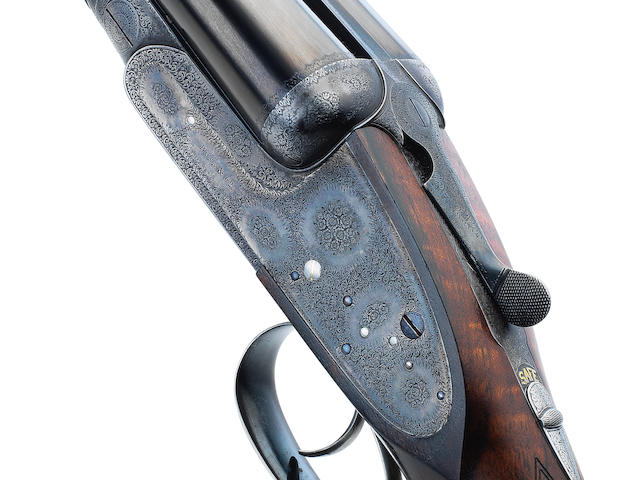 A fine 12-bore sidelock ejector gun by Boss & Co., no. 7456 In a brass-mounted leather case with a Boss & Co. trade-label