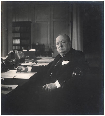 "CHURCHILL (WINSTON) Wartime photograph of Churchill, signed and dated on the mount ""Winston S. Churchill/ Feb.y 1942"", February 1942"