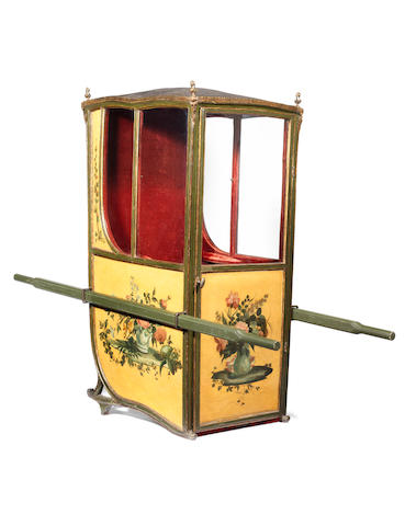 A French late 19th century polychrome decorated and parcel gilt sedan chair probably re-decorated