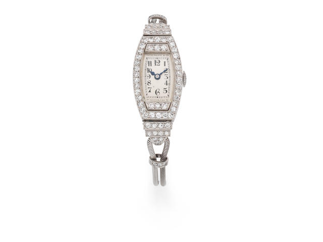 Patek Philippe. A lady's platinum and brilliant-cut diamond set manual wind cocktail bracelet watch Manufactured in 1927, Sold 22nd September 1936